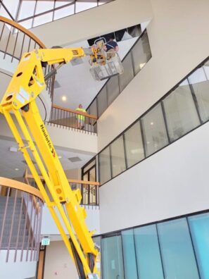 Commercial Building inspector using lift